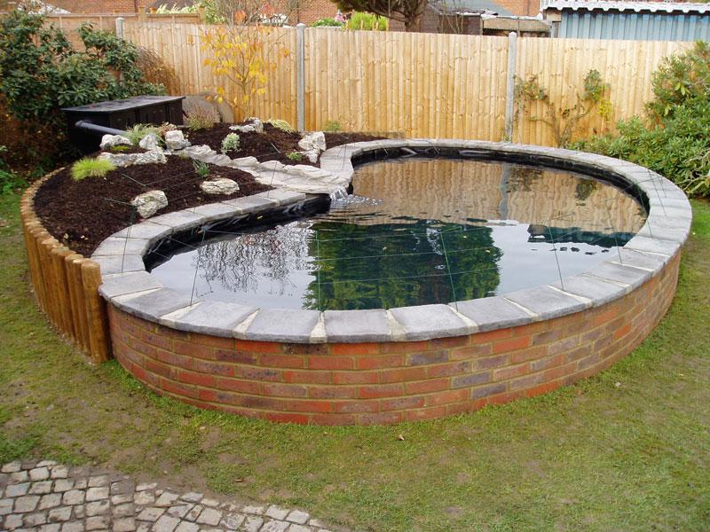 Garden landscaping construction farnham for Koi carp pond construction